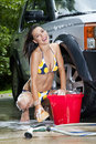 Brunette Model Washing Car Stock Photos