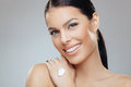 Brunette with moisturizer on her hand beautiful Stock Photography