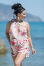 Brunette in pareo posing against sea looking away Royalty Free Stock Photo