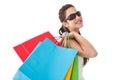 Brunette posing and holding shopping bags Lizenzfreies Stockbild