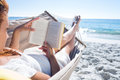 Brunette reading a book while relaxing in the hammock Royalty Free Stock Photo