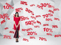 Brunette in a red dress with the shopping bags. Discount and sale symbols: 10% 20% 30% 50% 70%.Contemporary background. Royalty Free Stock Photo