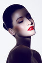 Brunette with red lipstick close up portrait of caucasian wearing spot lighting Royalty Free Stock Photos
