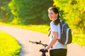 Brunette rides a bicycle on sunny morning Stock Photo