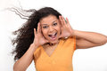 Brunette shouting through her hands Stock Photo