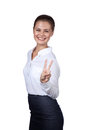 Brunette shows a symbol of victory bevushka dressed in office clothes confident and showing Stock Photo