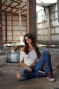 Brunette Sitting in Abandoned Warehouse (1) Royalty Free Stock Images