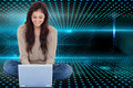 Brunette sitting on floor using laptop composite image of beautiful smiling Stock Photography