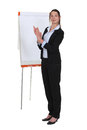 Brunette stood applauding by flip chart Stock Photos