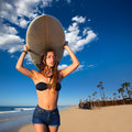 Brunette surfer teen girl holding surfboard in a beach newport california Stock Image