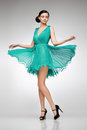 Brunette in teal dress Royalty Free Stock Image
