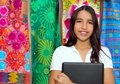 Brunette teen student indian latin holding laptop Royalty Free Stock Images
