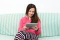 Brunette Teenage Girl Working On A Table PC in colorful outfit Royalty Free Stock Photo
