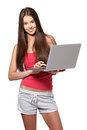 Brunette teenager with laptop on white background Stock Photo