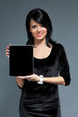 Brunette and touch pad device Royalty Free Stock Photos