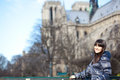 Brunette tourist in Paris near Notre-Dame de Par Royalty Free Stock Image