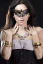 Brunette with venetian mask. Jewelry and Beauty. fashion photo Stock Images
