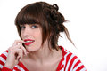 Brunette wearing stripy top red and white Royalty Free Stock Image