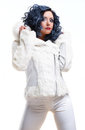 Brunette in white fur coat Royalty Free Stock Photography