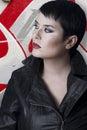Brunette woman against grafitti wall Royalty Free Stock Photo