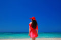 Brunette Woman on azure sea,Tropical Beach. Attractive girl in r Royalty Free Stock Photo