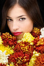 Brunette woman behind flowers pretty young Royalty Free Stock Photo