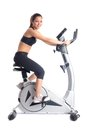 Brunette woman on bike  exerciser Royalty Free Stock Images