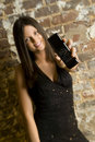 Brunette woman and cellphone Royalty Free Stock Photos