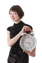 Brunette woman in dress holding clock over white Stock Photography