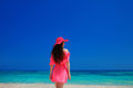 Brunette Woman enjoyng On Tropical Beach. Attractive girl in red Royalty Free Stock Photo