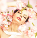 Brunette woman with flowers in her hair long Royalty Free Stock Photo