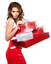 Brunette woman with a gift boxes Royalty Free Stock Photos