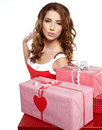 Brunette woman with a gift boxes Stock Images