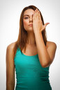 Brunette woman girl covered her face half hand this image has attached release Stock Image