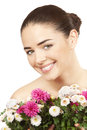 Brunette woman holding bouquet of flowers beautiful Stock Photography