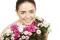 Brunette woman holding bouquet of flowers beautiful Royalty Free Stock Photography