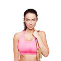 Brunette woman holding jump rope Royalty Free Stock Photo