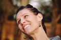 Brunette Woman Laughing Head tilted Royalty Free Stock Photo