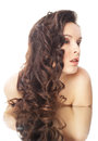Brunette woman with long wavy hairs on white Royalty Free Stock Image