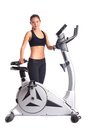 Brunette woman near bike  exerciser Stock Image