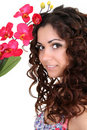Brunette woman with pink orchid Royalty Free Stock Image