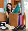 Brunette woman with purchases at home Stock Image