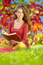 Brunette woman reading a book Stock Photography