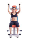 Brunette woman sitting on hydraulic exerciser Royalty Free Stock Photography
