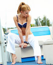 Brunette woman standing in a port bautiful sexy tanned fashion style sea background yachts Stock Photo