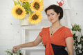 Brunette woman with sunflowers Stock Images