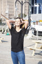 Brunette woman in sunlight cheerful posing urban setting Royalty Free Stock Photos