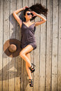 Brunette woman sunning on deck Royalty Free Stock Photo