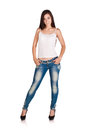Brunette woman in white t-shirt and blue jeans Royalty Free Stock Images