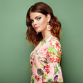 Brunette young woman in floral spring summer dress Royalty Free Stock Photo